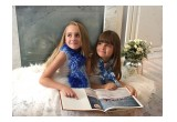 Hand-knit scarves for children made by owner Nataliya and her mother Olga