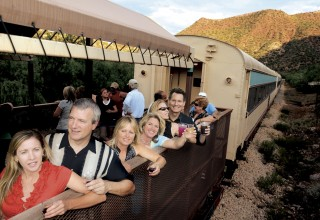 Passengers savoring the cooling evening air aboard Verde Canyon Railroad's Summer Starlight ride