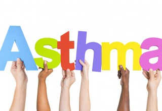 Hands holding letters spelling asthma