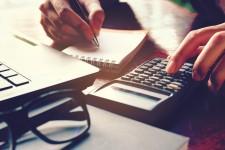 Person Calculating Finances