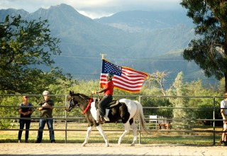 Veteran rider carrying the flag