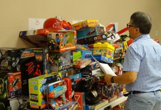 Dr. Norman Quintero goes over list of toys donated