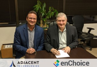 Dave Parks, CEO of Adjacent Technologies, and Tony White, CEO of enChoice, sign the merger agreement.