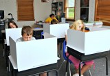 "Students using the 13"" tall desktop study carrel."