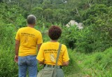 Scientology Volunteer Ministers approach a village in the rain forest inland from the Amazon.