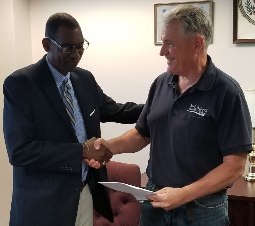 Photo Caption: Mr. Jeffery Jones explaining to Capt. Edward Nanartowich the Courses being offered by The American School for International Business which will complement the courses being offered by MAMA.