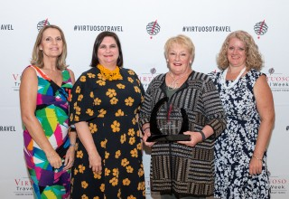 Travel Experts' Management Team Accepts 2019 Top Virtuoso Air Production Award
