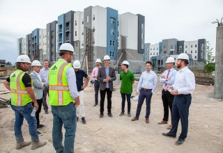 Small group walking tour of The Hub Apartments site