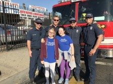 Youth for Human Rights volunteers with members of the LA Fire Department at the Martin Luther King Day parade