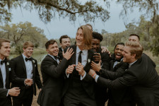 NFL star Trevor Lawrence with his groomsmen in INDOCHINO at his wedding to Marissa Mowry Lawrence.