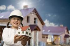 Girl Holding Model House Signifying Family Life