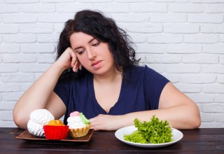 Dieting Woman Yearns for Cupcakes