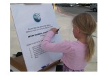 Youngster takes her first step toward a drug-free life by signing the Foundation for a Drug-Free World pledge at a booth at Randsburg, California, Old West Days.