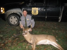 Officer Borkovich with poached 8 point buck