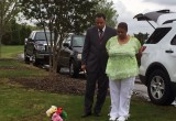 Freda Waiters and Rev. Vicion Jones at Ariston's gravesite.