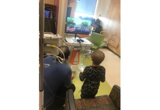 Patient at Phoenix Children's Hospital enjoying Walker Charities donation of gaming system