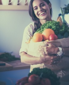 Woman Holding Grocery Bag Filled with Produce