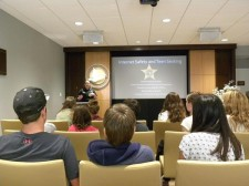 Pinellas County Deputy Sheriff briefed Clearwater teens on how to protect their privacy and prevent cyberbullying at a workshop at United for Human Rights Florida headquarters in downtown Clearwater.