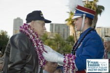 Band Member presenting Lei to Pearl Harbor Survivor