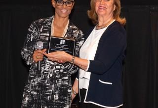 Dr. Bello gives Diana Rowan Rockefeller the Woman of the Year Award January 2019