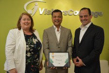 VisitorsCoverage Accepts Award From IMG