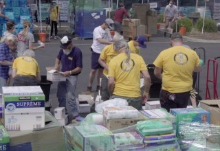 Volunteer Ministers working in a supply distribution center after the Carr Fire.