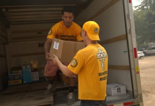 Loading a truck with needed supplies.