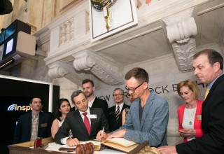 Inspire CEO, Robert Netzly, signing NYSE bell ringer book