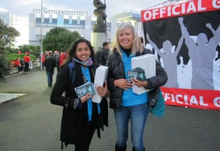 Volunteers distributing copies of Truth About Drugs booklets at a recent All Blacks rugby game