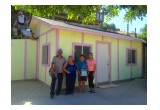 The Real Family standing in front of their new home in Tijuana.
