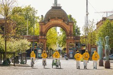 Scientology Volunteer Ministers pass by Copenhagen's famous Tivoli amusement park en route to distributing Stay Well booklets in shops throughout the city