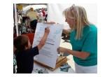 Kern Country Drug-Free World Coordinator Vicki Rizzardini helps children pledge to live drug-free lives at the Randsburg Old West Days.