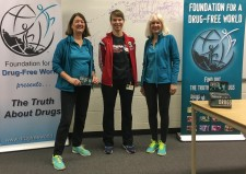 Foundation for a Drug-Free World volunteers (in aqua  shirts and jackets) at a drug education program presented  to students at Resurrection Catholic Secondary School in  Waterloo, Ontario.