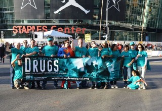 Drug-Free World volunteers at Staples Center at the NBA All-Star game, where they handed out 30,000 copies of Truth About Drugs booklets to fans.