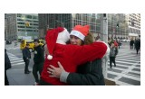 Santa Hugs Homeless Man