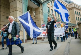 """The group marched to Edinburgh International Conference Centre chanting """"childhood is not a mental disorder."""""""