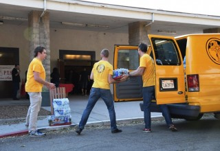 Volunteer Ministers deliver supplies to evacuation center