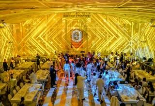 220 guests dancing.