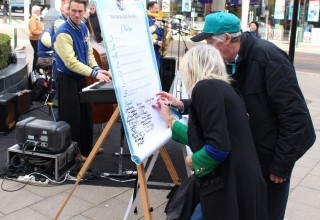 The team was raising funds for Drug-Free World activities in Sussex, such as this drug-free pledge drive in Crawley, featuring the Jive Aces, UK's No. 1 Jive & Swing band.