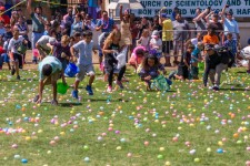 "It was a lively race to pick up their share of the more than 30,000 eggs, 100,000 pieces of candy and the 300 ""Golden Eggs"" that could be exchanged for large stuffed bunnies."