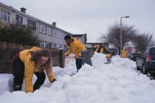 Volunteers from the Scientology Community Centre help the community dig out from the snowstorm