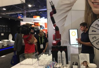 A Journalist Experiencing a Brain-Controlled Industrial Robot