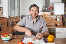 Happy Guy Cooking Alone