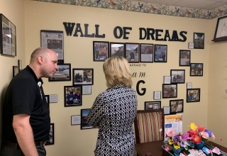 Stutzman learns about Waterford Place's Wall of Dreams