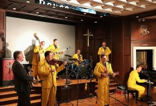 The Jive Aces Swing into Health concert at the Nashville Church of Scientology World Health Day Concert. Church pastor Rev. Brian Fesler (left) joins them on banjo.