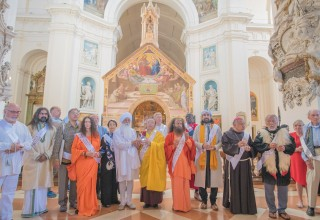Religious Leaders outside of the Portiuncula within the Basilica of Saint Mary of the Angels, holding the water contained in the heart shaped vessel.