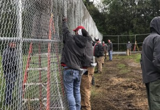 100 Percent of RGF Employees Working Together on 10-foot-high Fence Installation