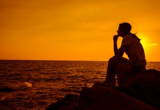Woman Sitting Alone Thinking About Climate Change