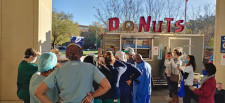 The Simply Done Donuts Wagon serves its trademark mini donuts and artisan coffee to nurses and staffers from Emory Johns Creek Hospital