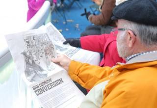 Bryant Park Visitors reading about Coercive Conversion